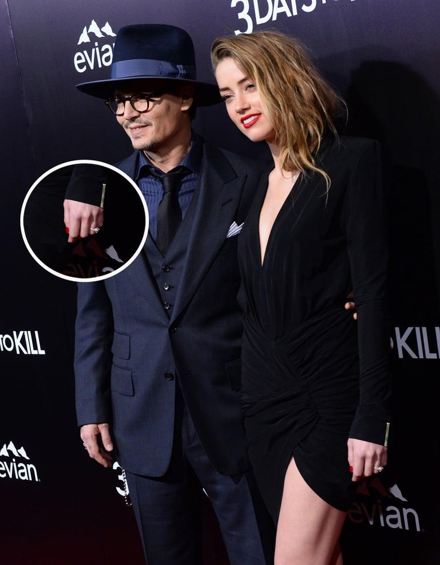 Johnny Depp ja Amber Heard keskiviikkona 3 Days To Kill -elokuvan ensi-illassa. Parin on huhuttu menevän naimisiin Johnnyn yksityissaarella Bahamalla. Kuva MVphotos
